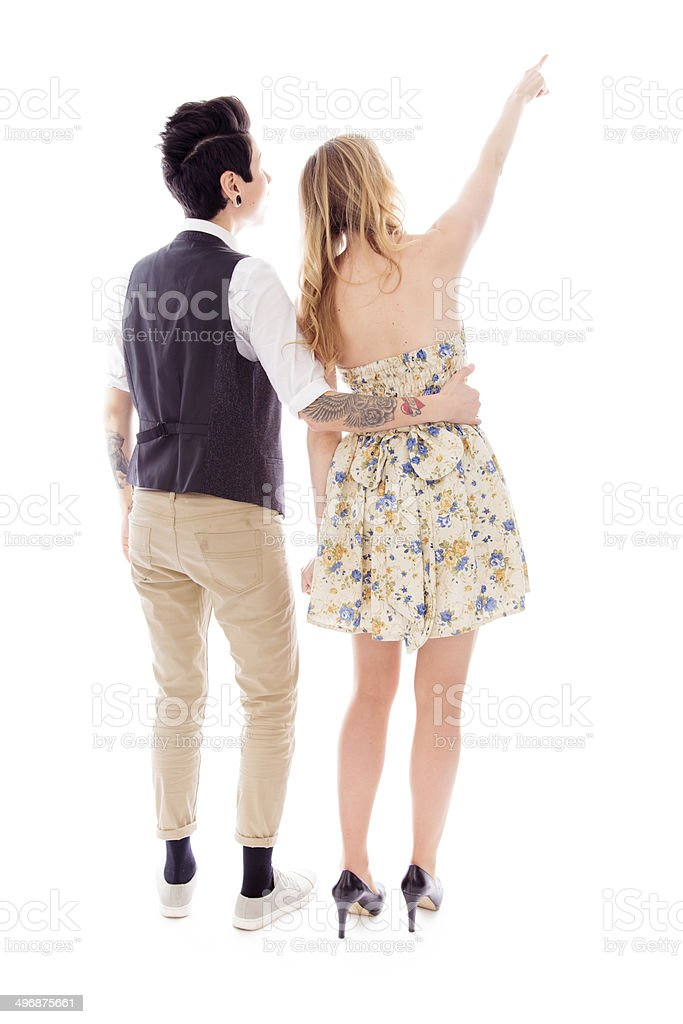 Rear view woman showing something to her lesbian partner stock photo
