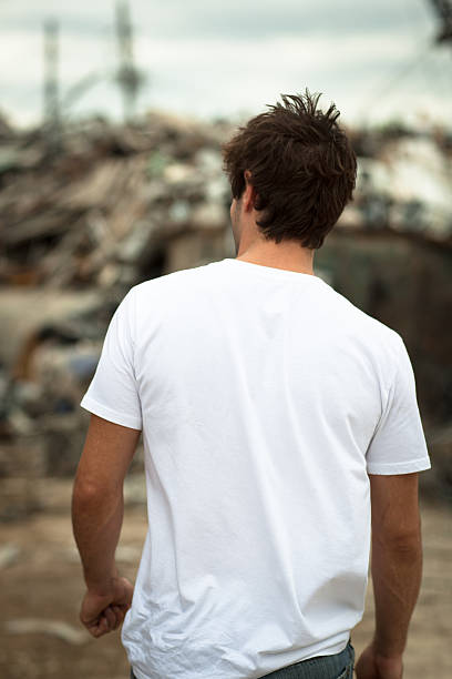 Rear view young male outdoors wearing white t-shirt stock photo