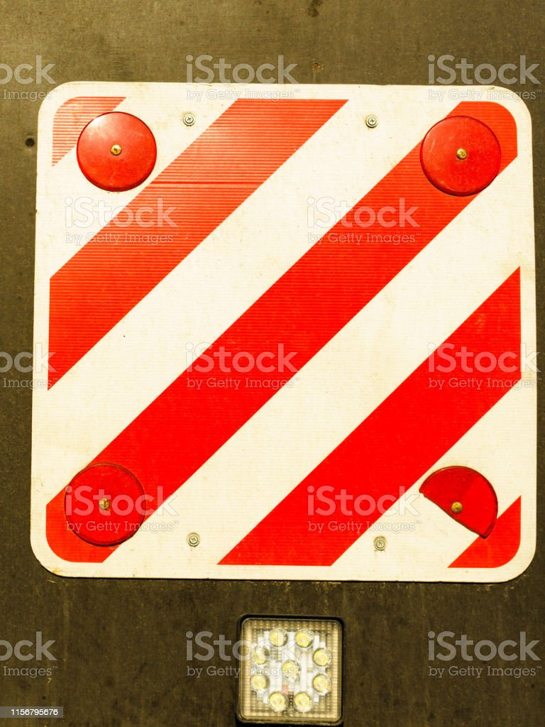 Rear warning striped sign white and red for safety on back of large...