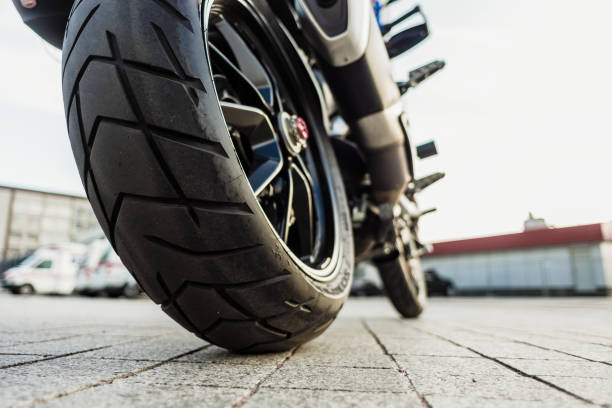 rear wheel of motorcycle - motorbike racing stock photos and pictures