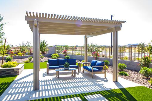 Rear Yard Pergola Covering Patio Furniture
