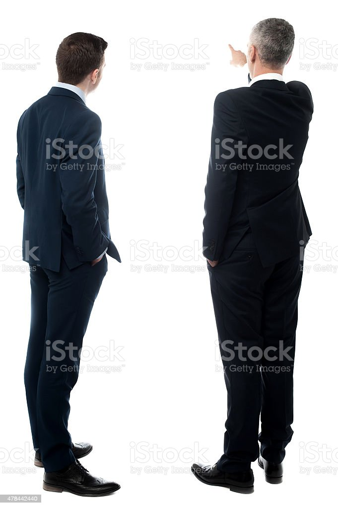 Rear-view image of two businessmen stock photo