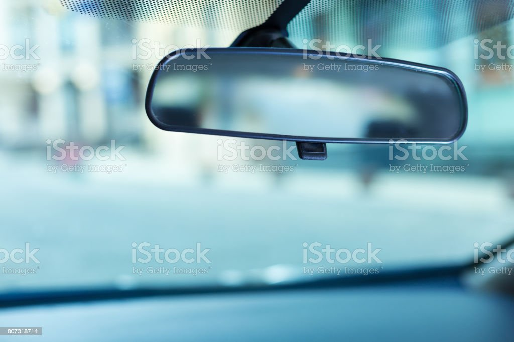 Rear-view mirror adjusted to the windshield stock photo