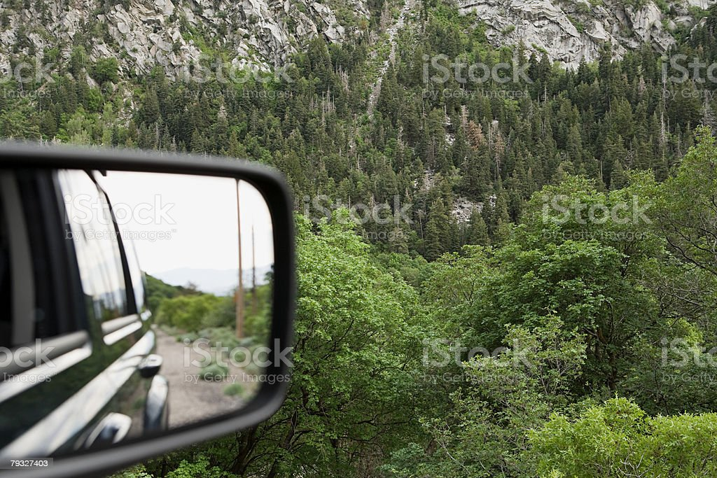 Rearview mirror and mountainside 免版稅 stock photo