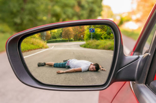 Rearview mirror with a man hit by a car stock photo