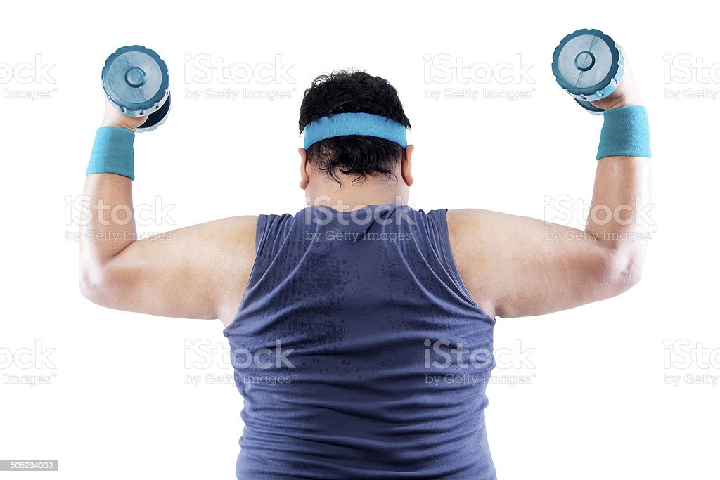Rearview overweight man doing fitness stock photo