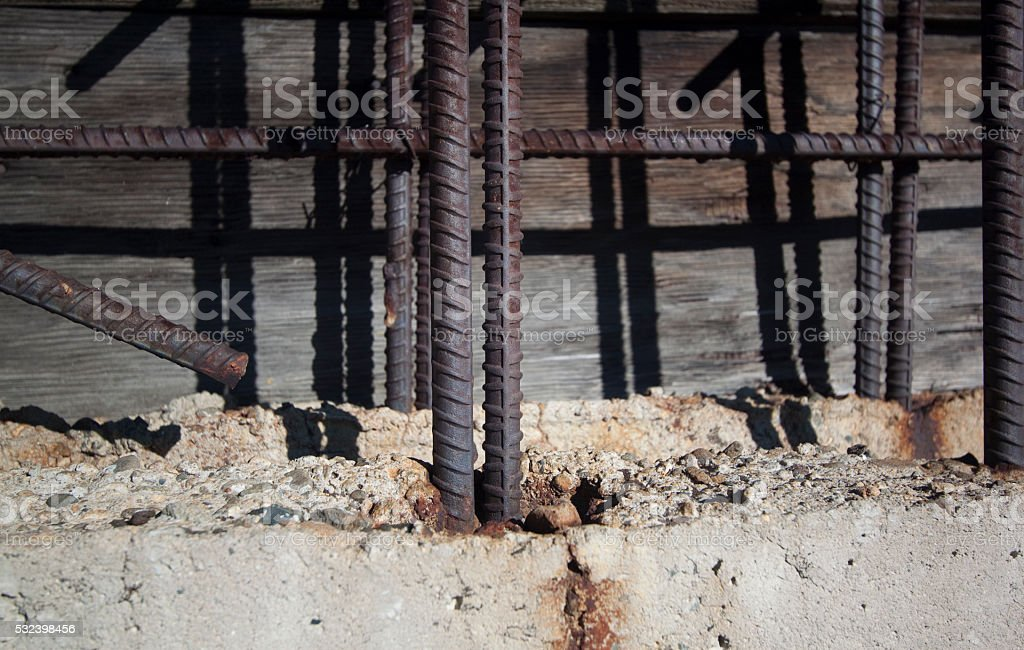 Rebar coming out of cement stock photo