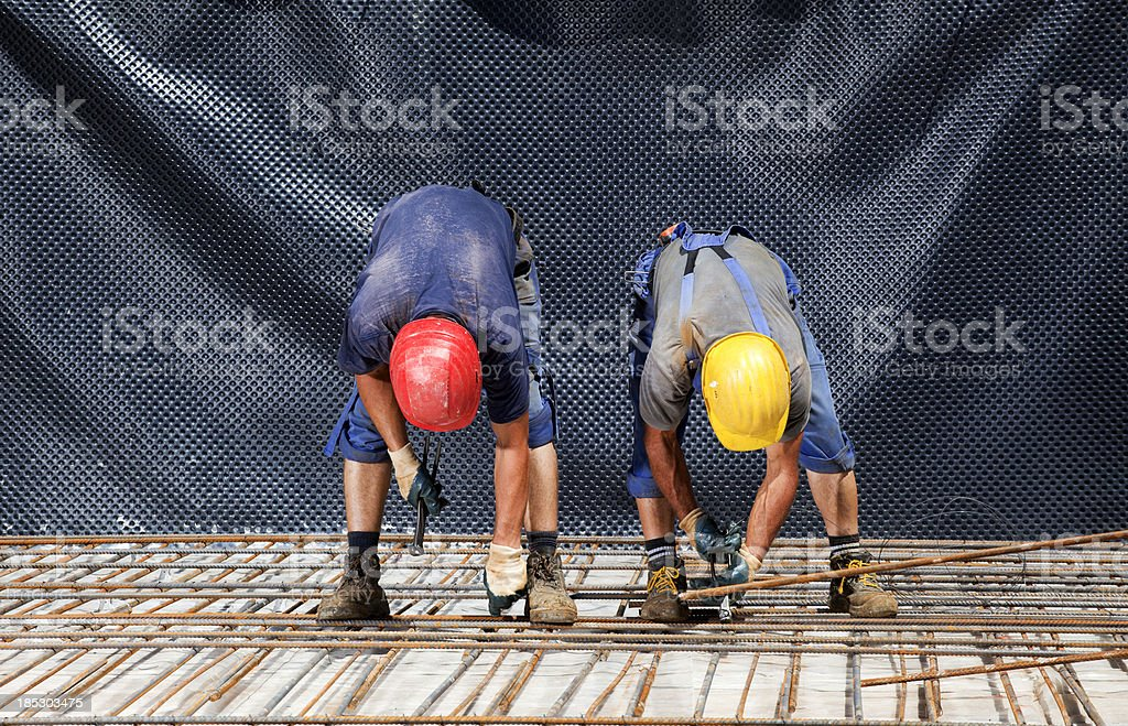 rebars before pouring concrete,  positions  and secures steel reinforcing bars stock photo