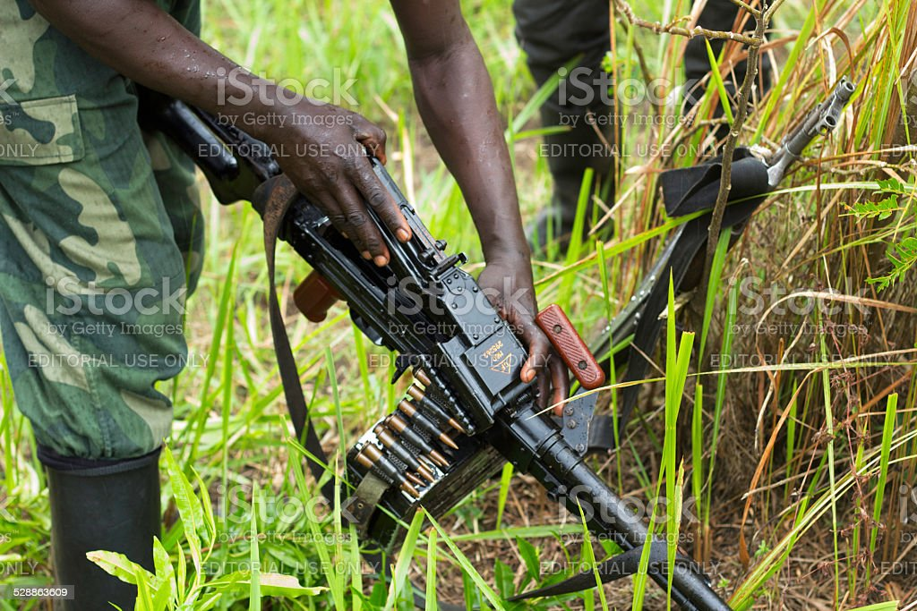 FDLR Rebel Checking Weapon stock photo