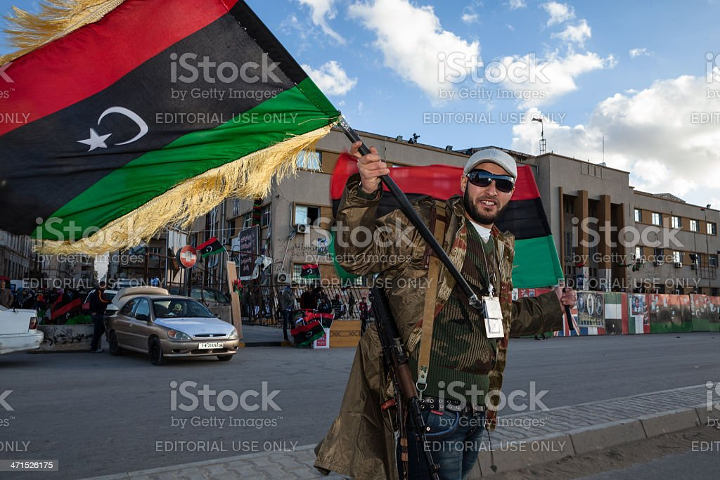 Rebel with a flag and Kalashnikov stock photo