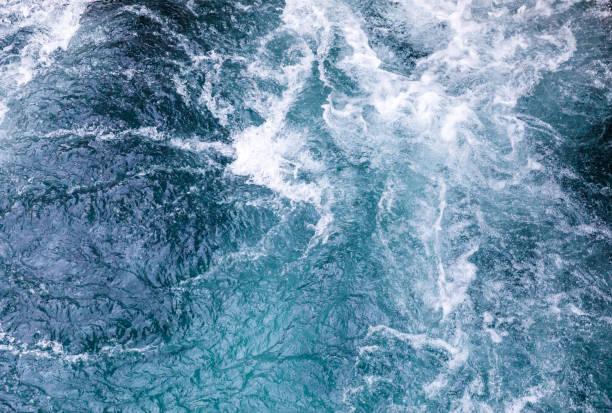 Rebellious blueish and greenish water stock photo
