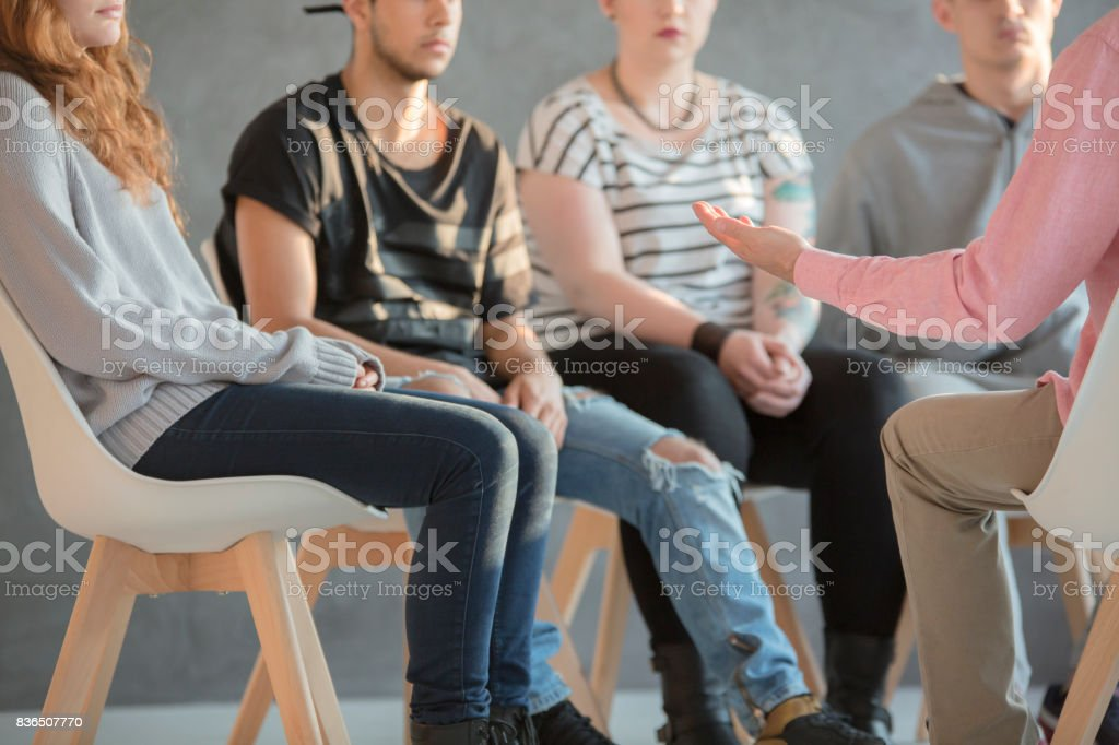 Rebellious youth at psychotherapy stock photo