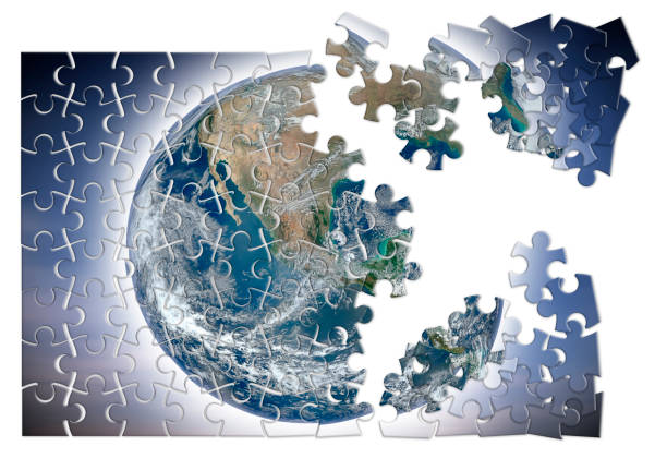 Rebuild the world - concept image with elements from Nasa in jigsaw puzzle shape stock photo