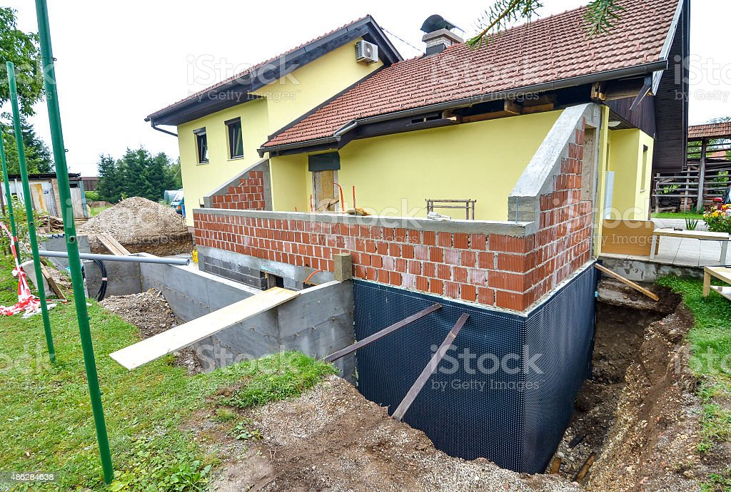 Rebuilding a family house and adding an  extension stock photo