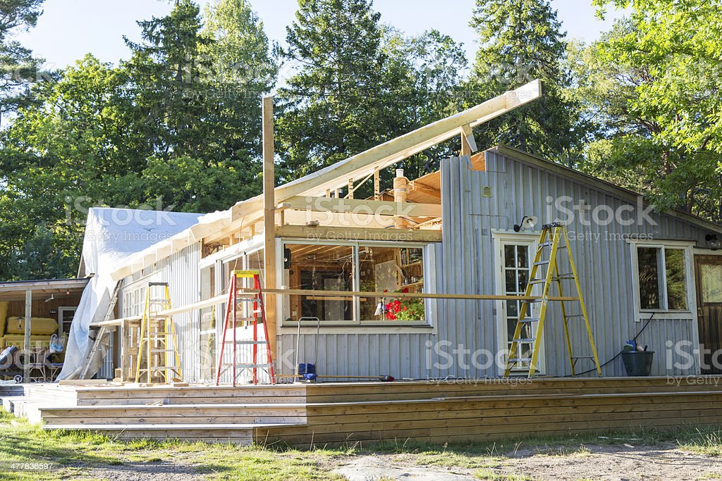 Rebulding the roof of country home stock photo
