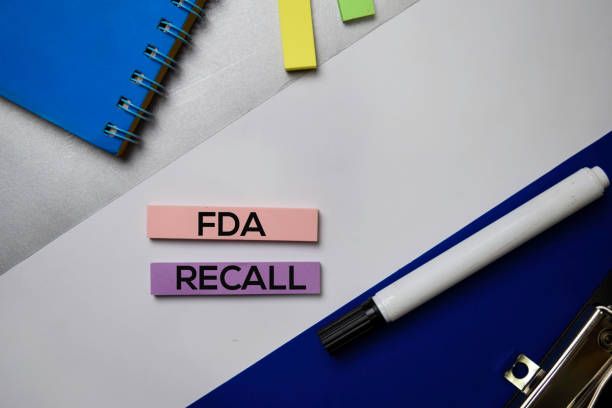 fda recall text on sticky notes with color office desk concept - fda stock photos and pictures