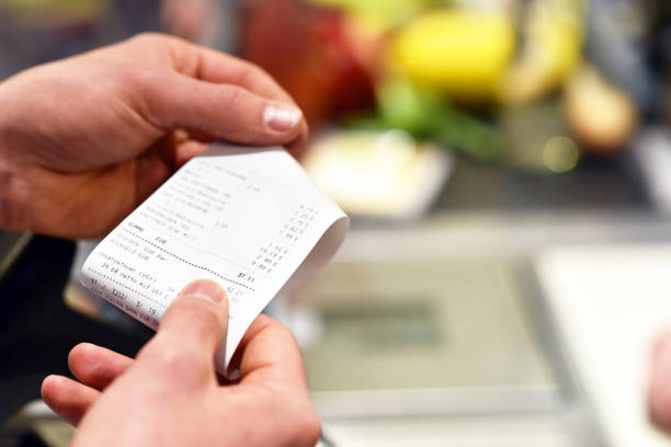 receipt after payment in the supermarket stock photo