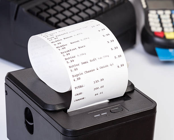 receipt printer with paper shopping bill. - receipt stock photos and pictures