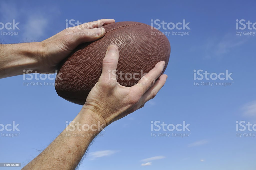 Receiver Catching an American Football Pass stock photo
