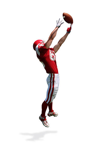 Receiver Making Catch with Clipping Path Wide receiver making leaping catch. Clipping path included in file. Slight motion blur to accentuate action. wide receiver athlete stock pictures, royalty-free photos & images