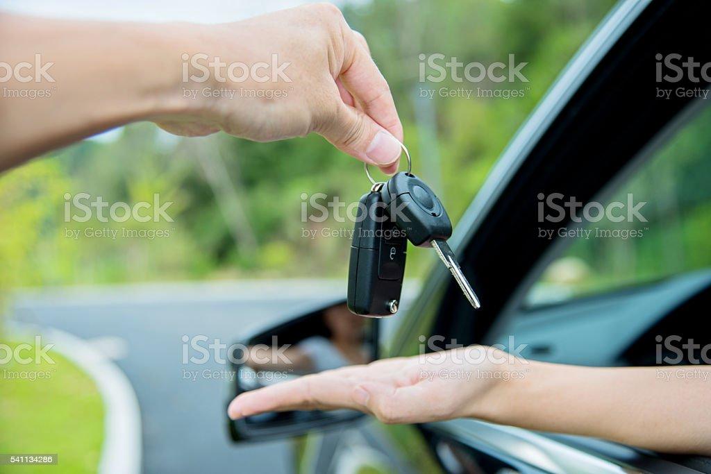 Receiving car key stock photo