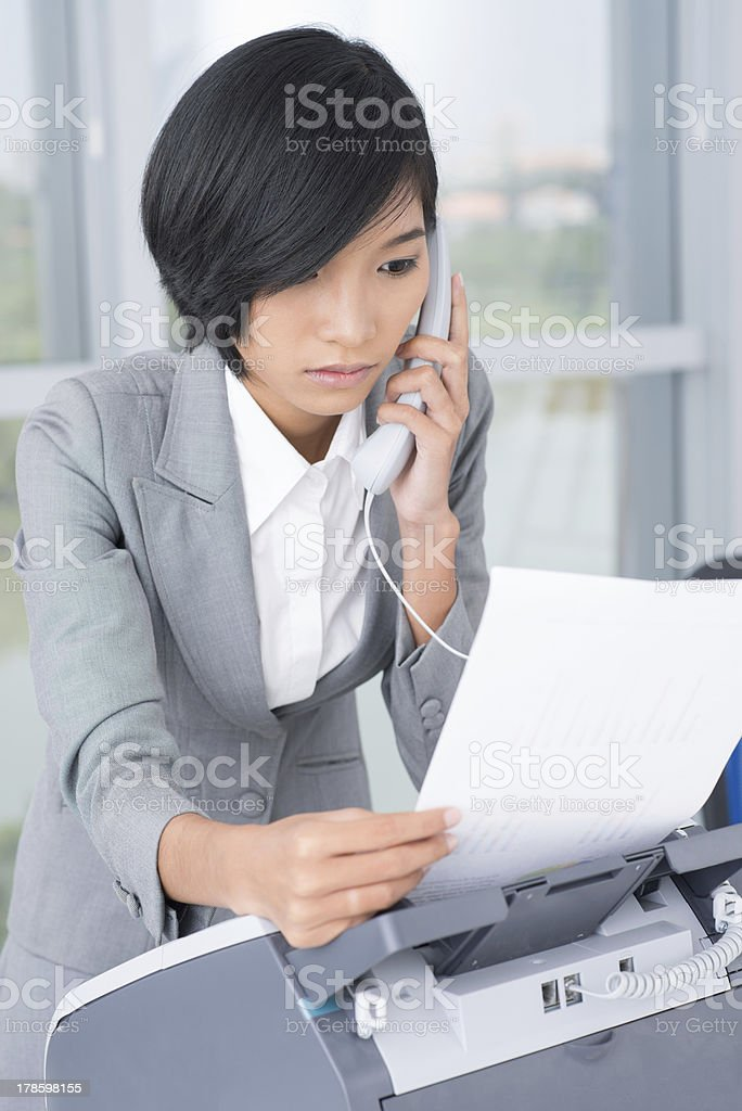 Receiving fax document stock photo