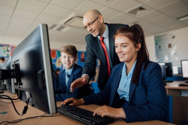 receiving help in a lesson - униформа стоковые фото и изображения
