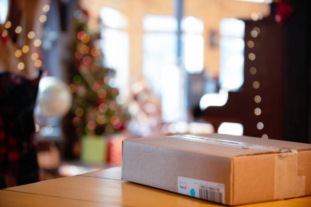 receiving online shopping from mail - manonallard stock photos and pictures
