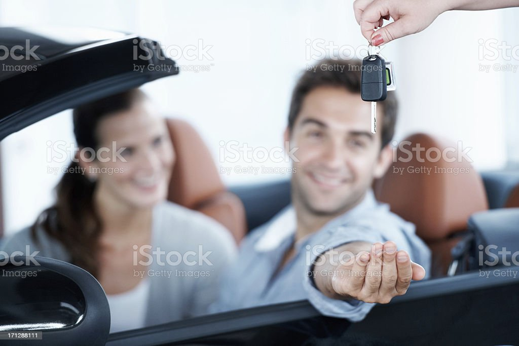 Receiving the keys to a new world of motoring stock photo