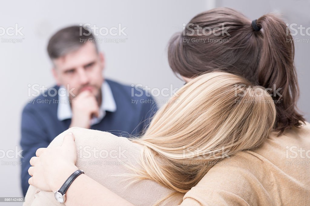Receiving understanding and support from her therapy group stock photo