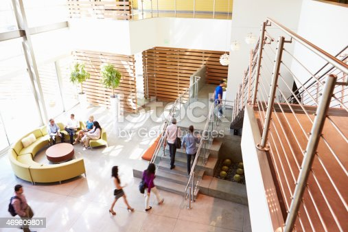 504879112istockphoto Reception Area Of Modern Office Building With People 469609801