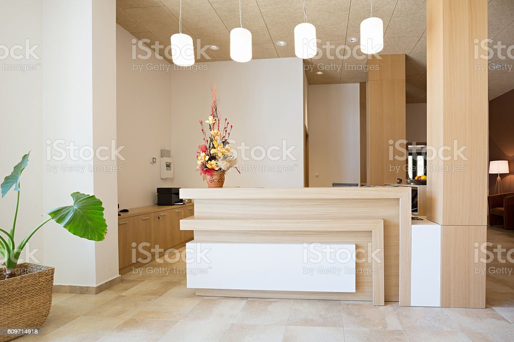 Reception area with wooden reception table stock photo