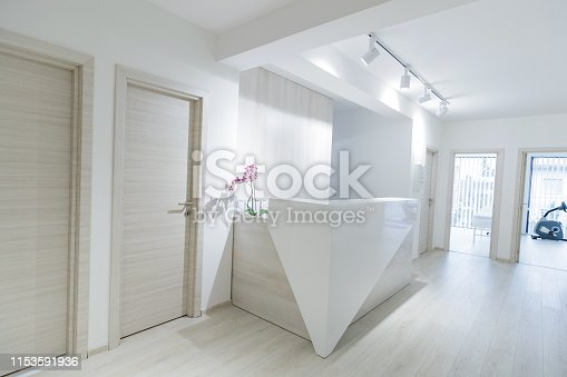Empty reception desk in the clinic with doctors' offices