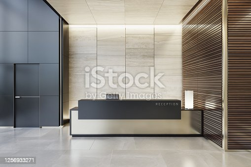 Luxurious reception desk interior room with natural stone marble tiles and wood panels decoration.\nCopy space on desk and walls.\nStylish interior area with a modern architectural details.\nNatural stone floor. Ceiling with strip cove lighting and white spotlights.