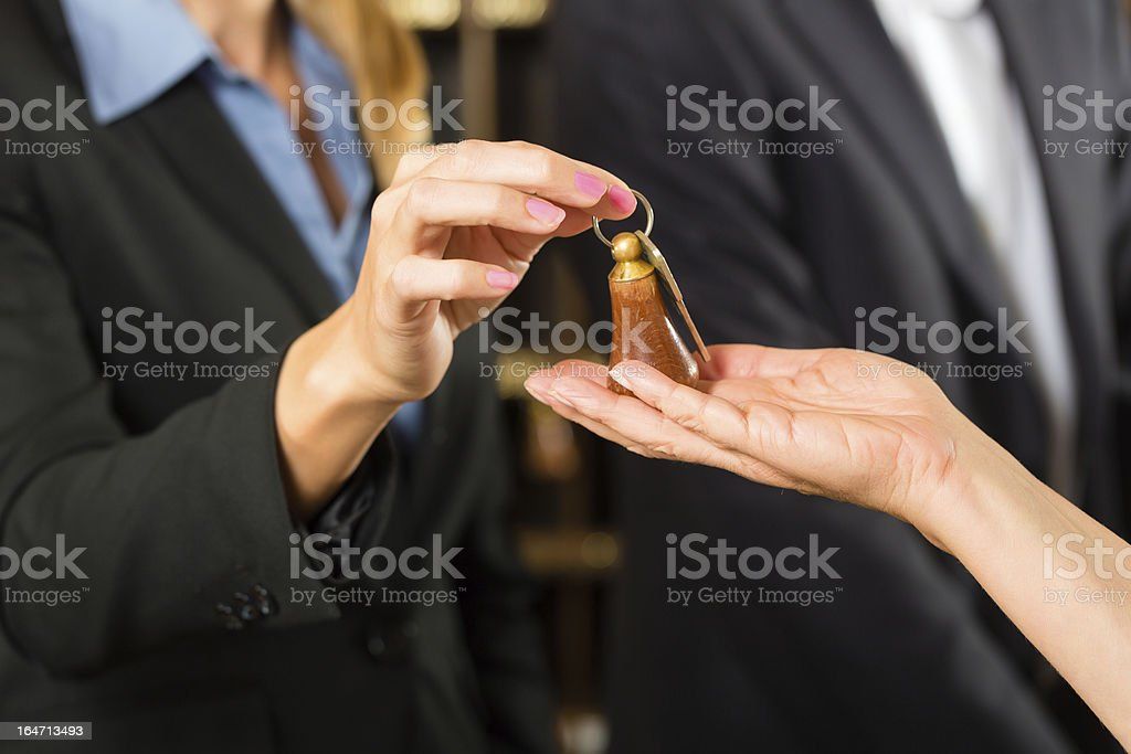 Reception - Guest checking in a hotel royalty-free stock photo