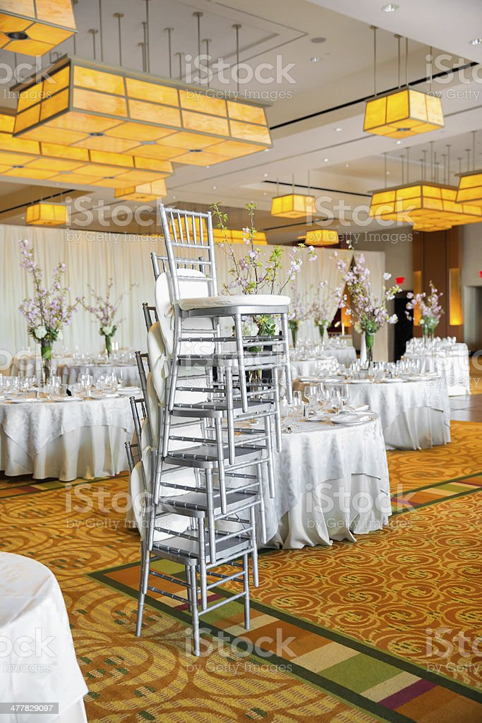 Reception room being set for a wedding royalty-free stock photo