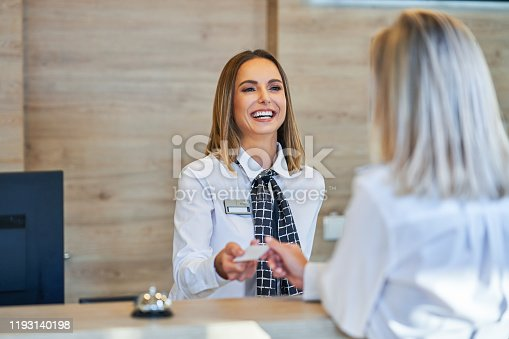 Picture of receptionist and businesswoman at hotel front desk