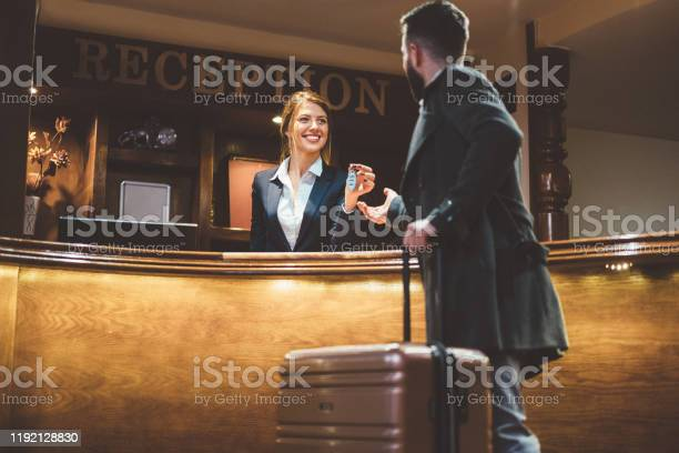 Receptionist giving keys to hotel guest picture id1192128830?b=1&k=6&m=1192128830&s=612x612&h=m0pg yf9pbbz5ygwogdv2wg2gqeajkh2vlqz89ksubg=