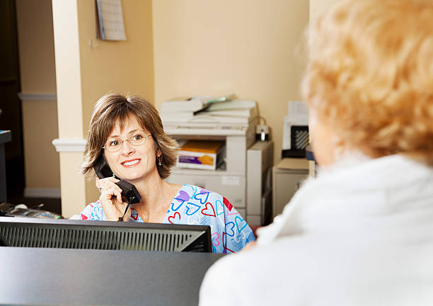 Royalty free doctors office receptionist clinic computer pictures doctors office receptionist clinic computer pictures images and stock photos sciox Images