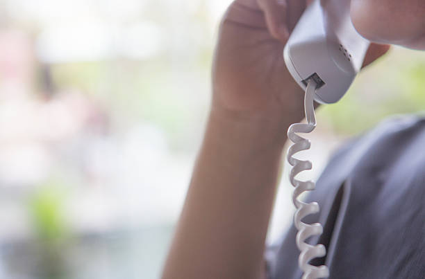 Receptionist holding a phone stock photo