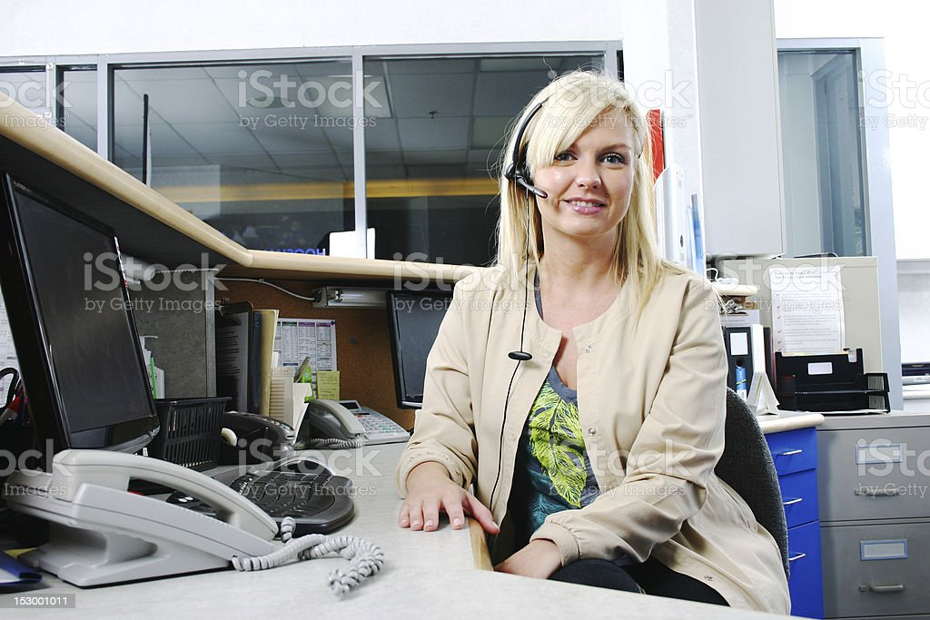 Receptionist in dental office stock photo