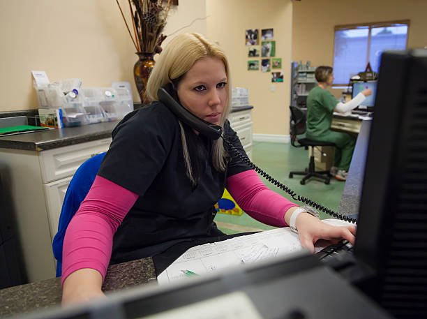 Receptionist on Phone in Animal Hospital stock photo
