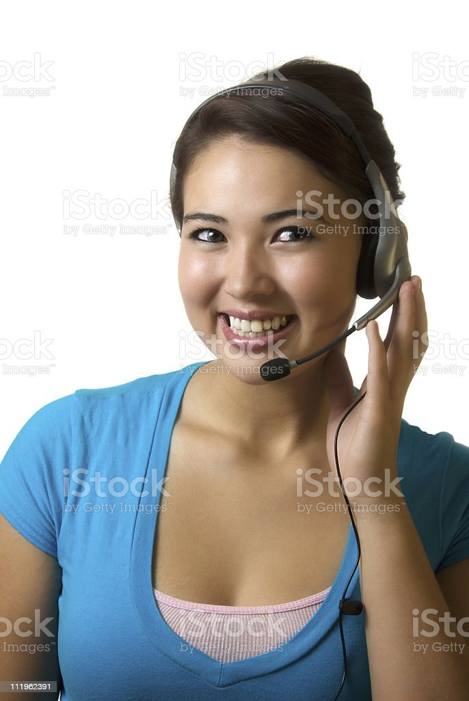 Receptionist - smiling young woman with a headset on white royalty-free stock photo