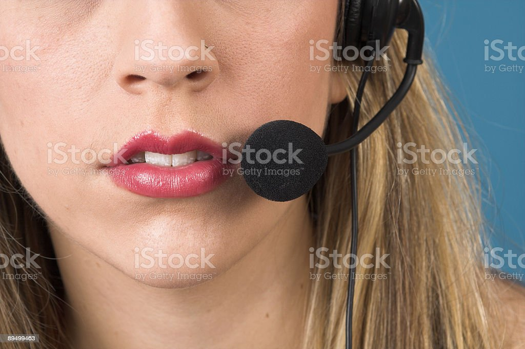 Receptionist with headset royalty free stockfoto