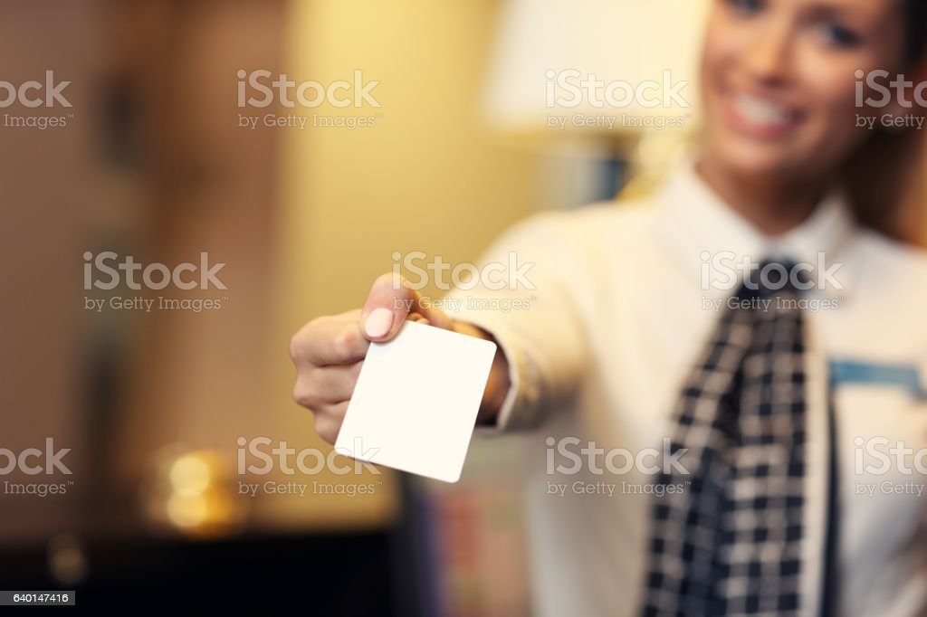 Receptionist with key card stock photo