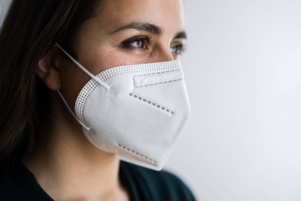 Receptionist Woman In Medical Face Mask stock photo