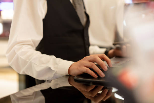 Receptionist working at counter stock photo