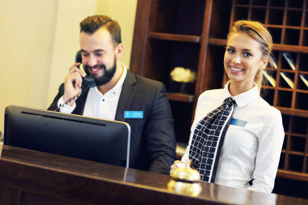 Receptionists at work Picture of two receptionists at work concierge stock pictures, royalty-free photos & images