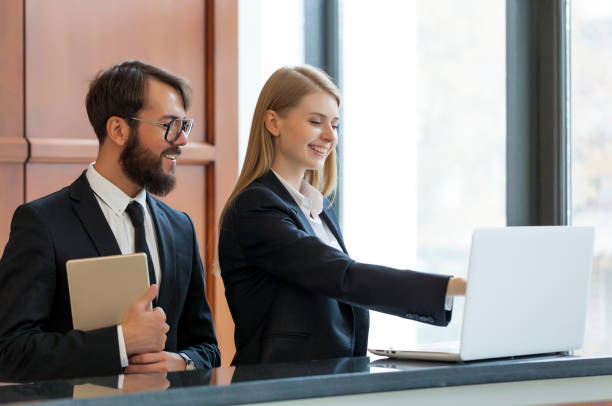 receptionists at work - hotels stock photos and pictures
