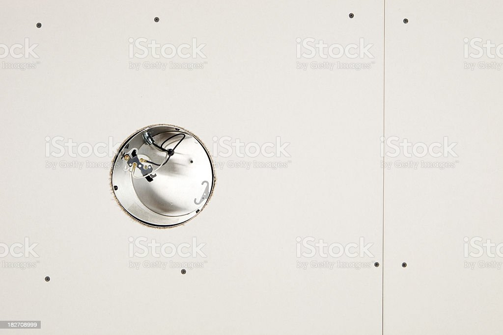 Recessed Can Light in New Sheetrock Ceiling stock photo